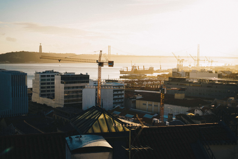 brown tower crane at sunset