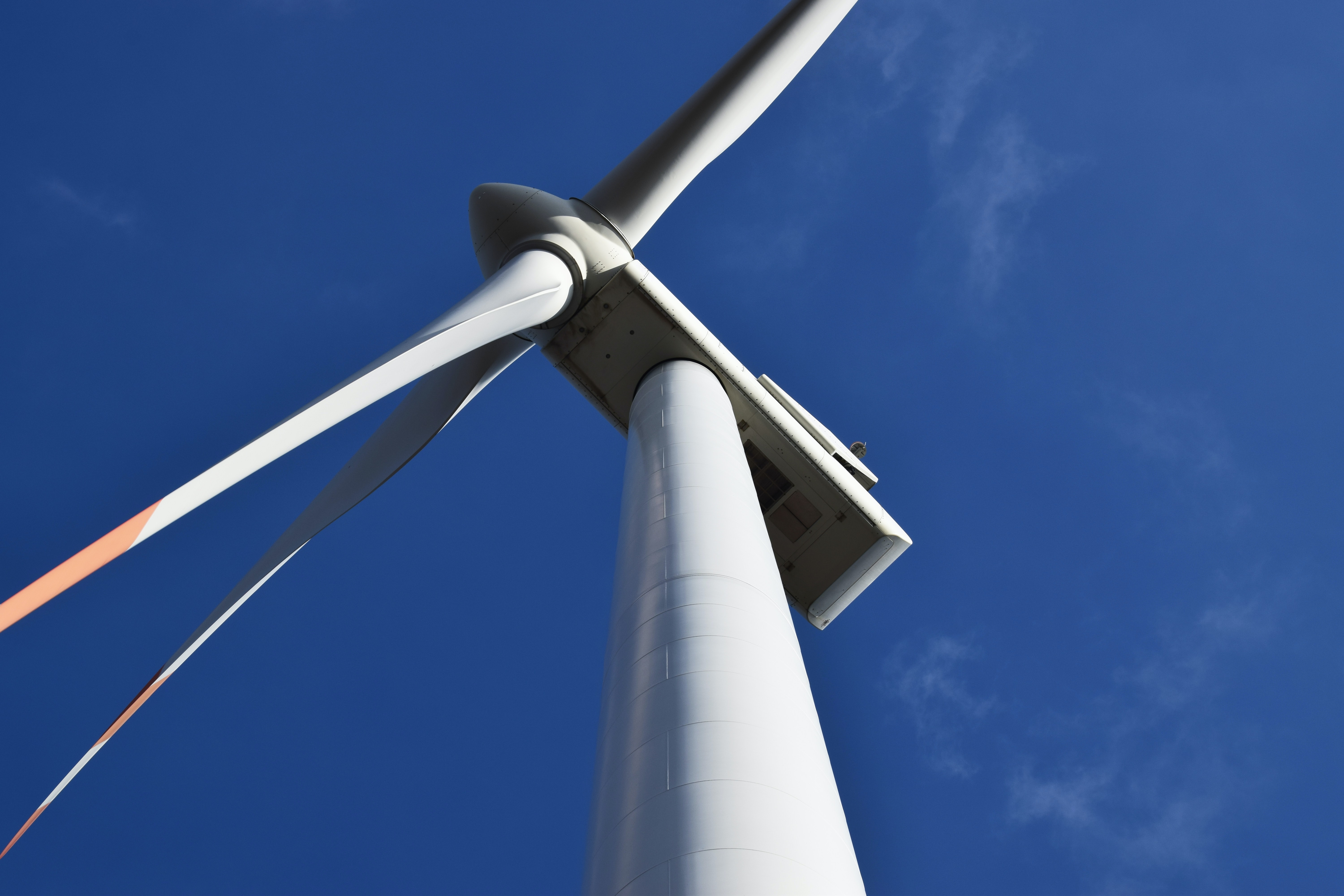 low angle photo of white metal windmill