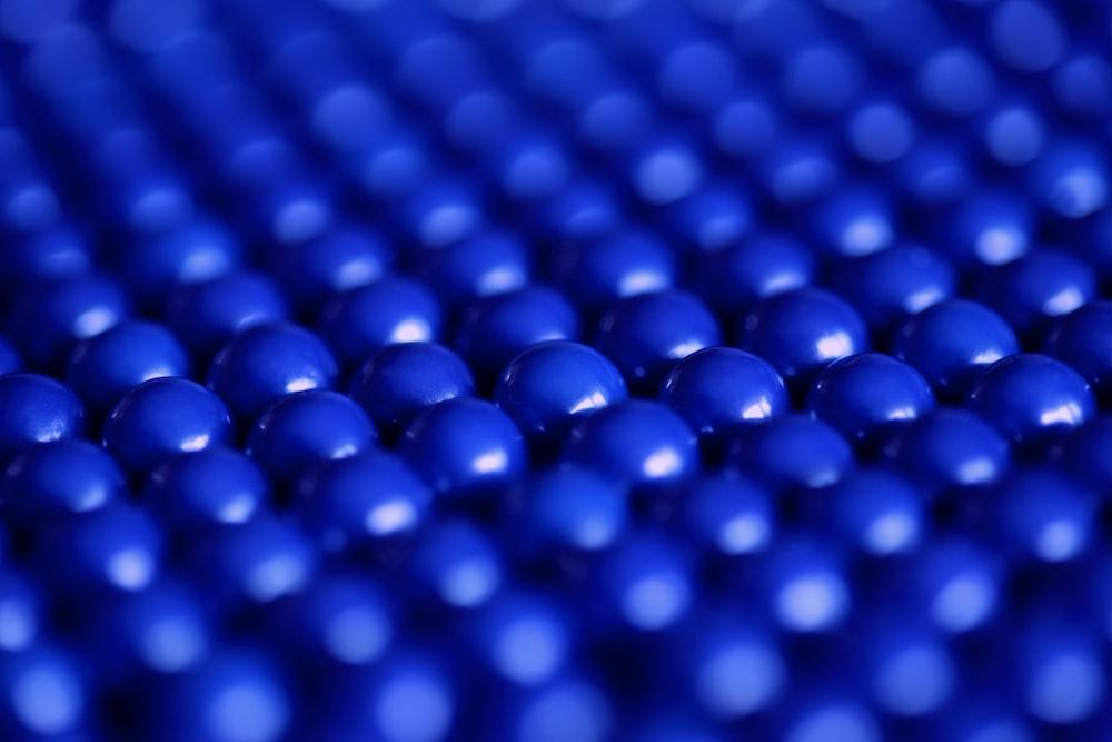 close up photography of blue balls digital wallpaper