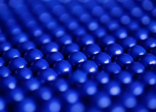 close up photography of blue balls digital wallpaper