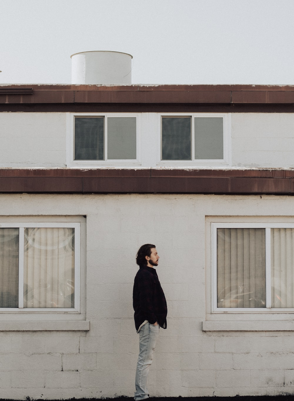 man standing on front of residential building