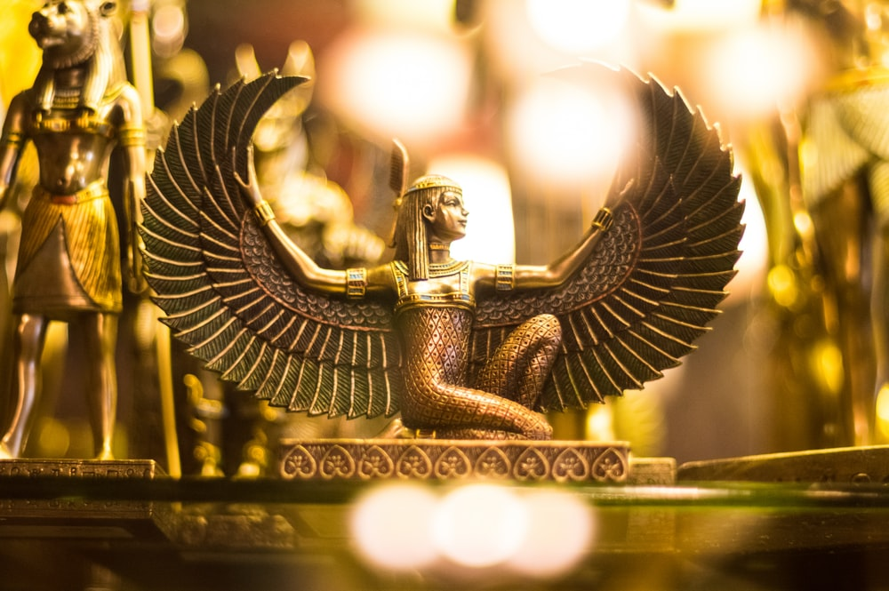 Goddess Isis figurine wallpaper
