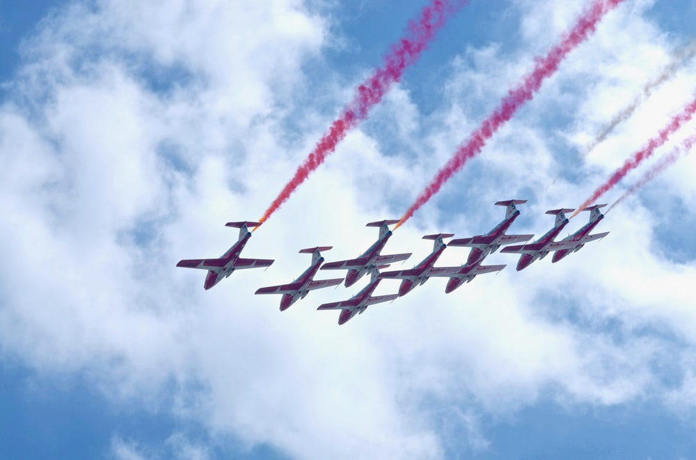 white-and-red planes in mid air