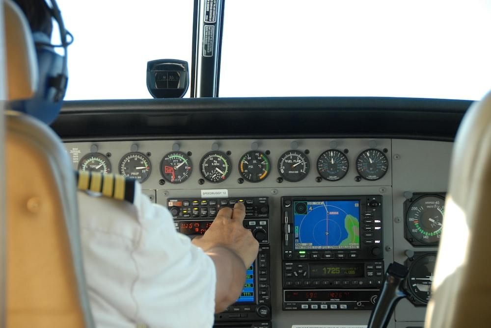 pilot controlling airplane dashboard