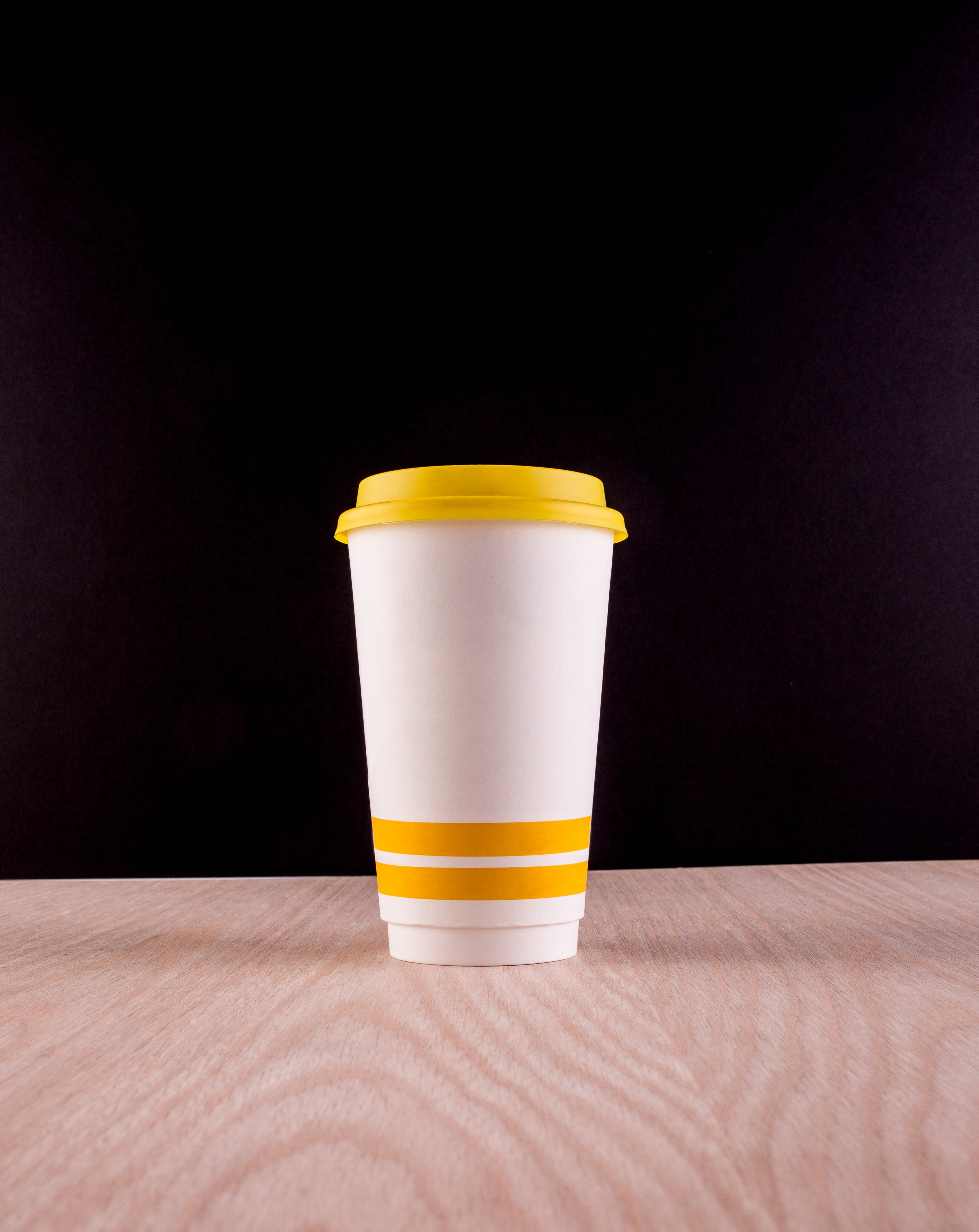 white and yellow plastic cup