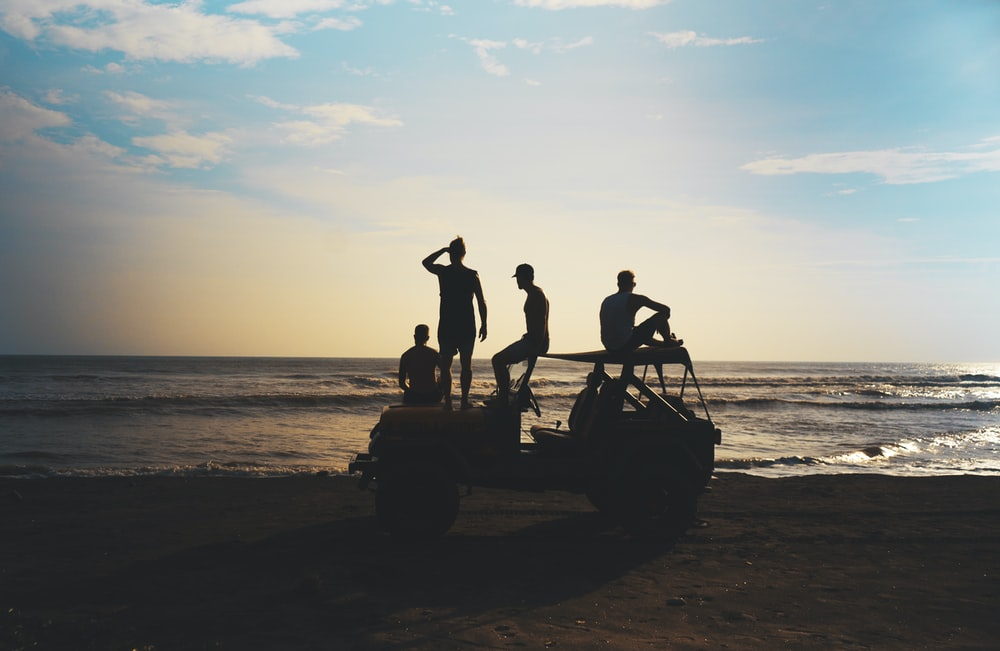 group of people riding SUV during daytime