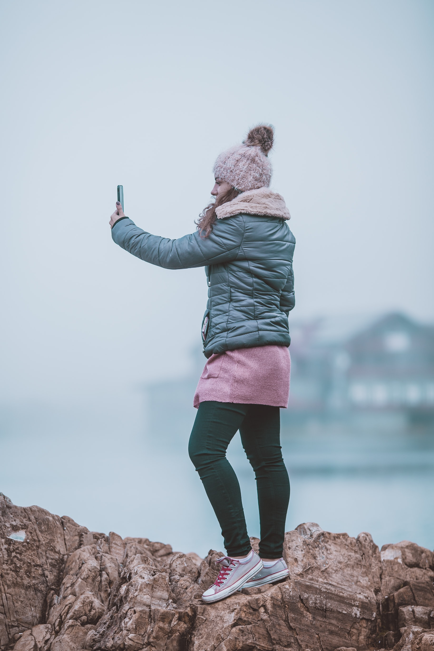 woman taking a selfie on rock