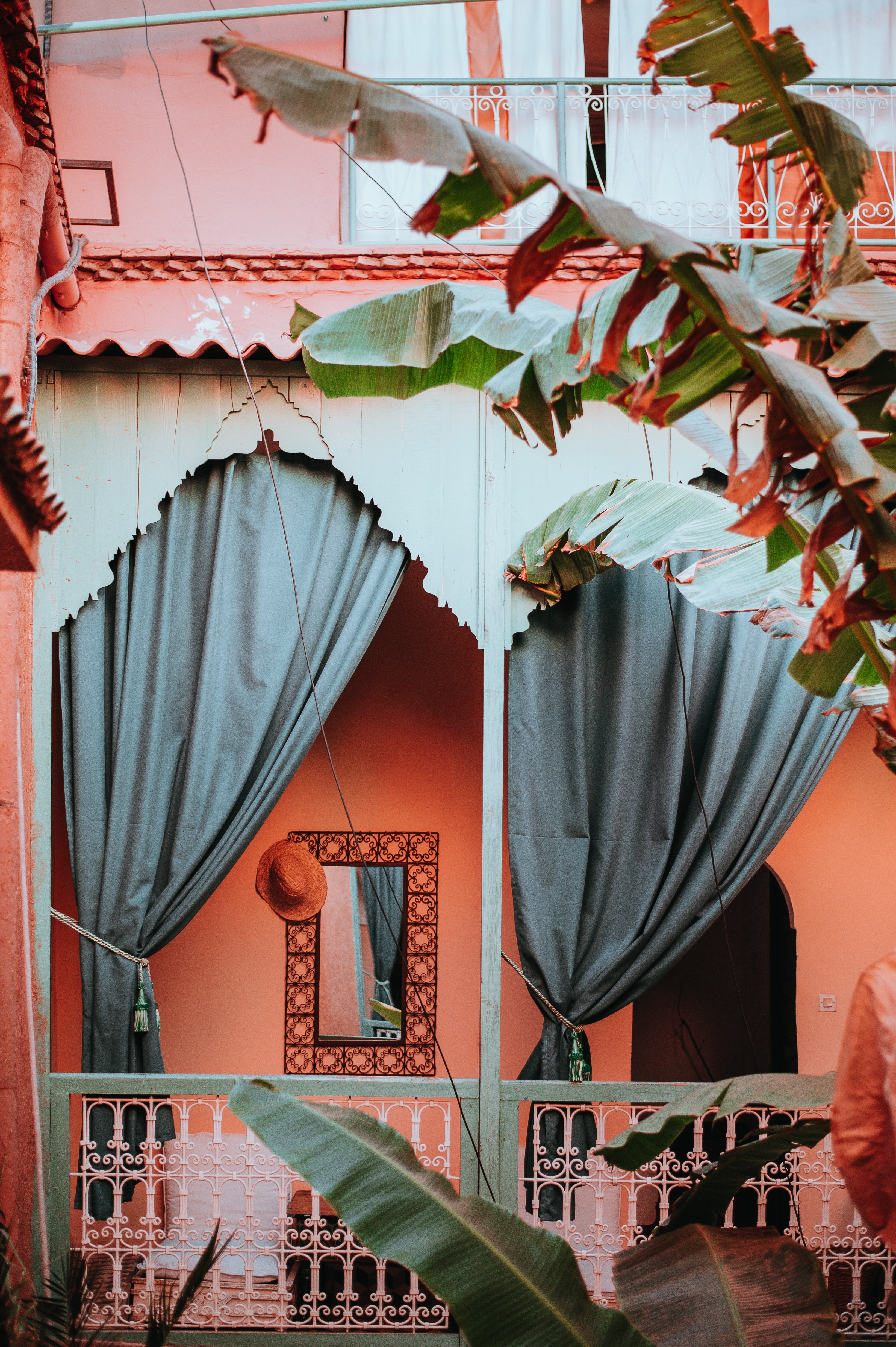 two gray curtains on brown house