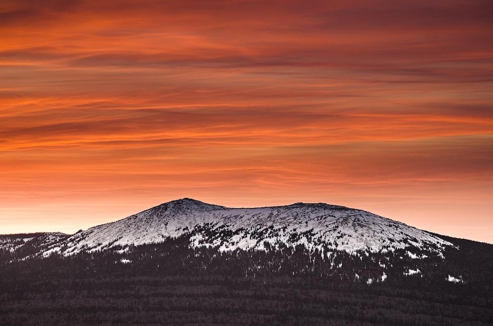 mountain alps with orange sky