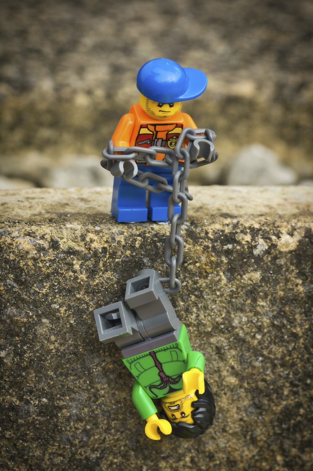 LEGO characters toy on gray concrete surface