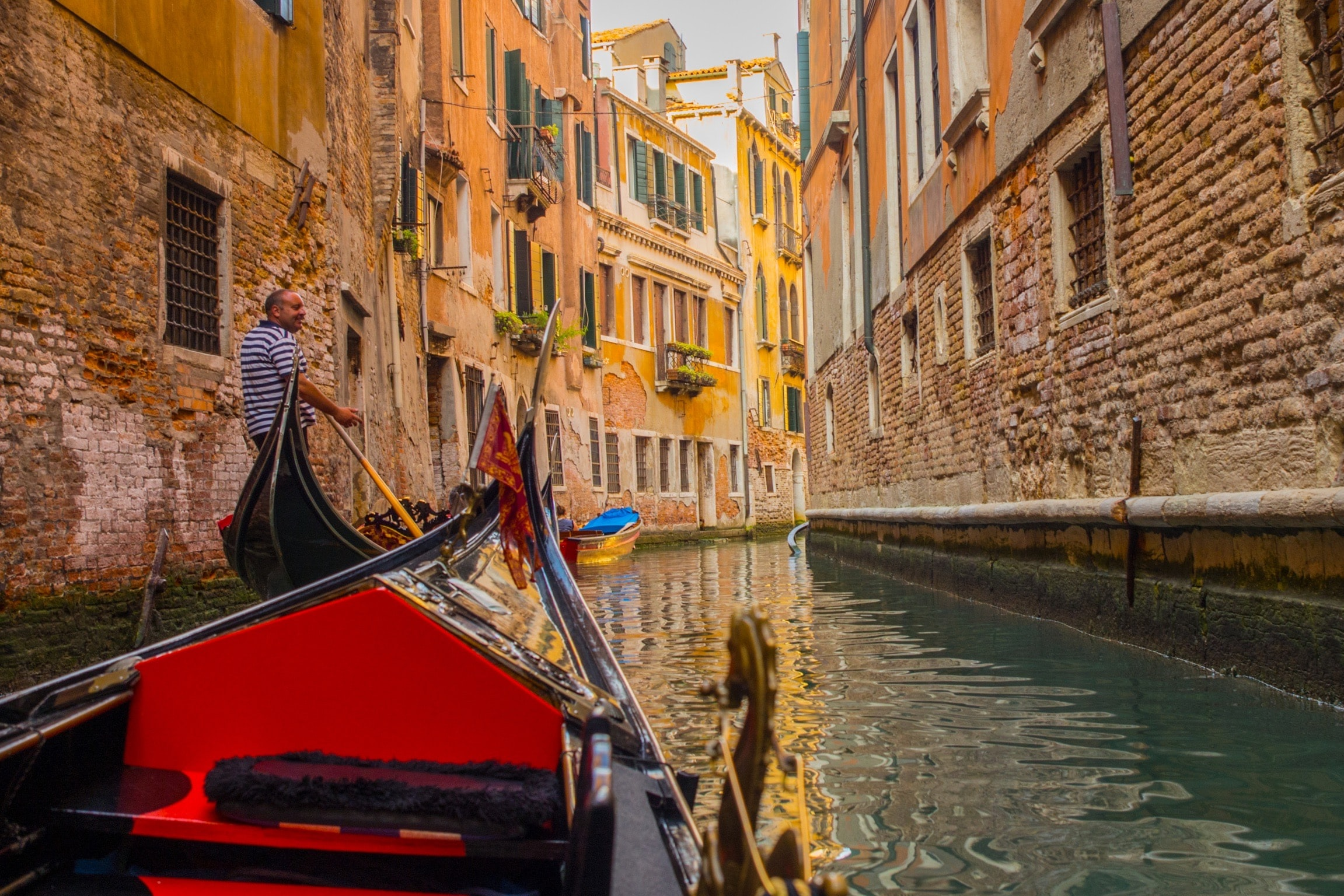 man on canoe in Venice Grand Canal