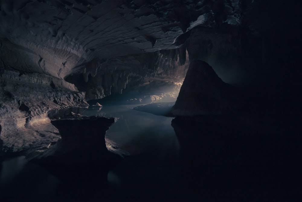 cave interior with body of water