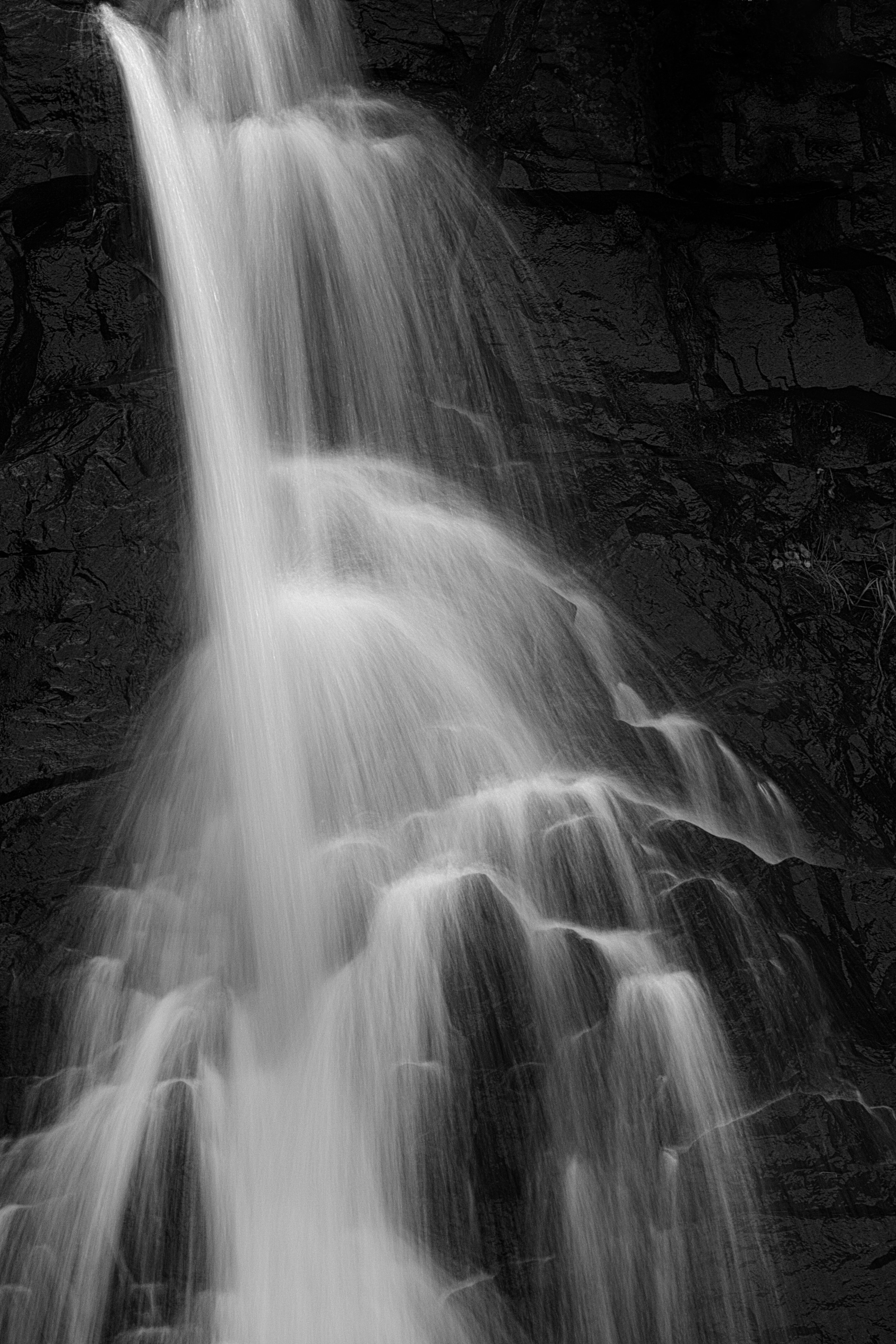 grayscale photo of waterfall