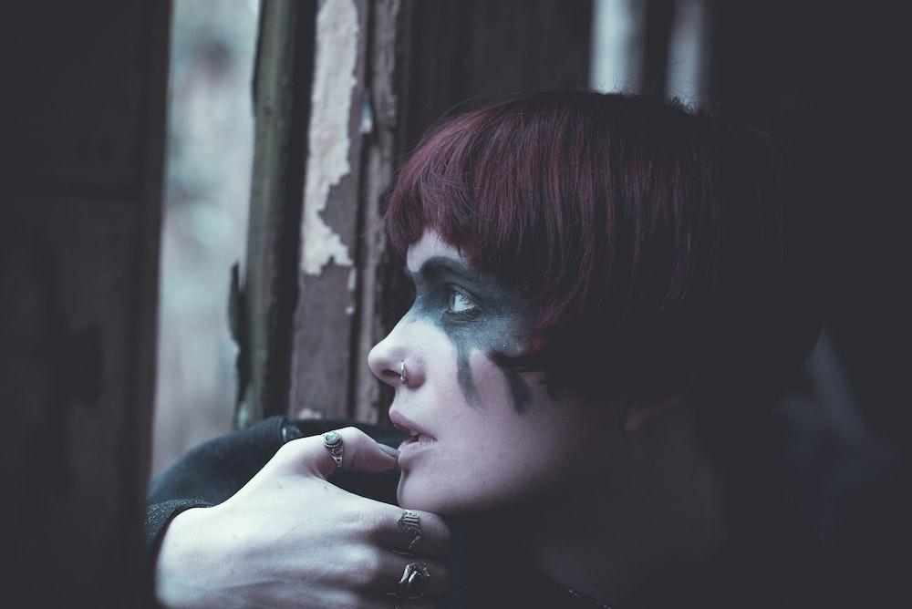 woman staring on window