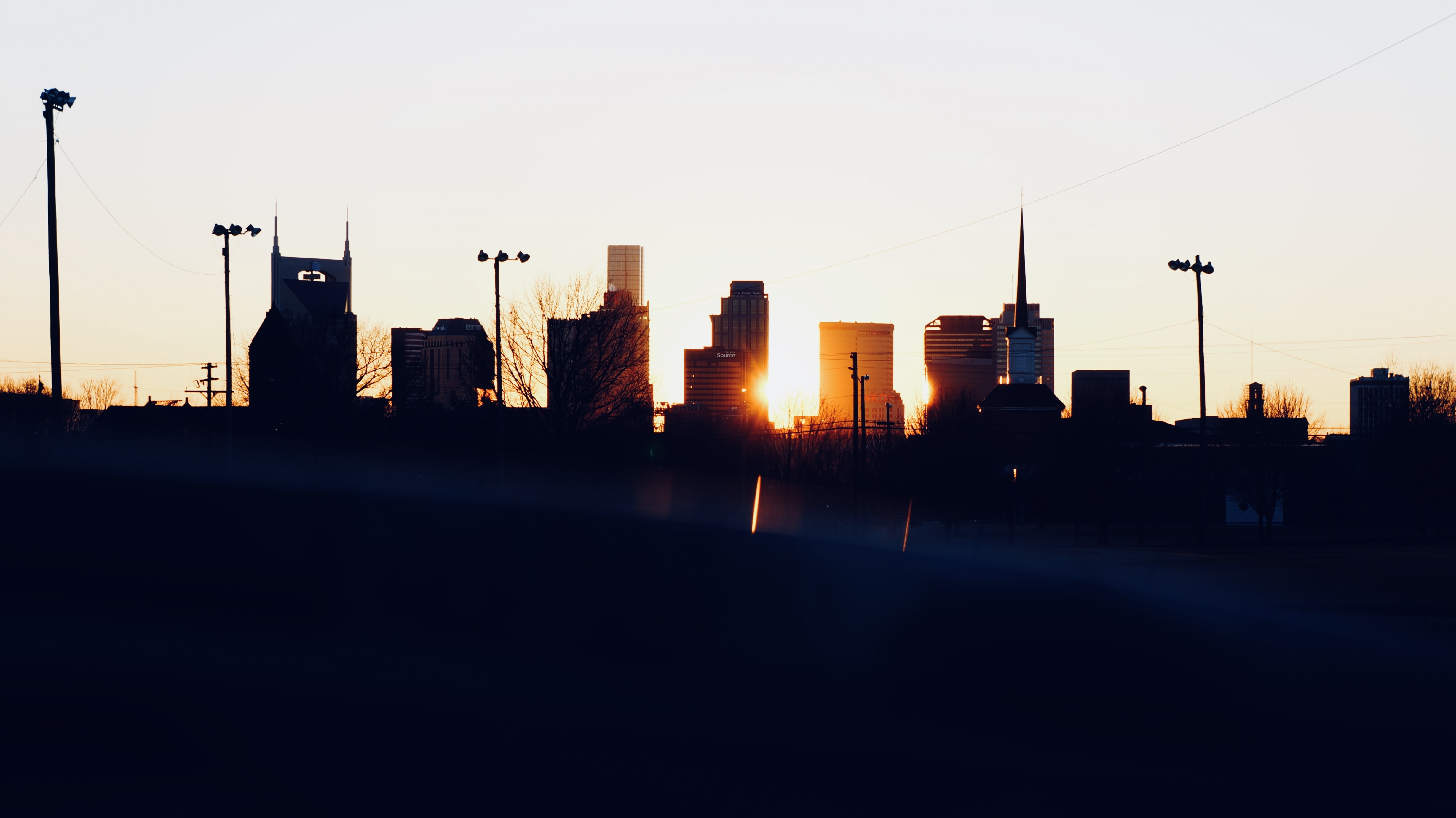 silhouette photo of city building during sunset