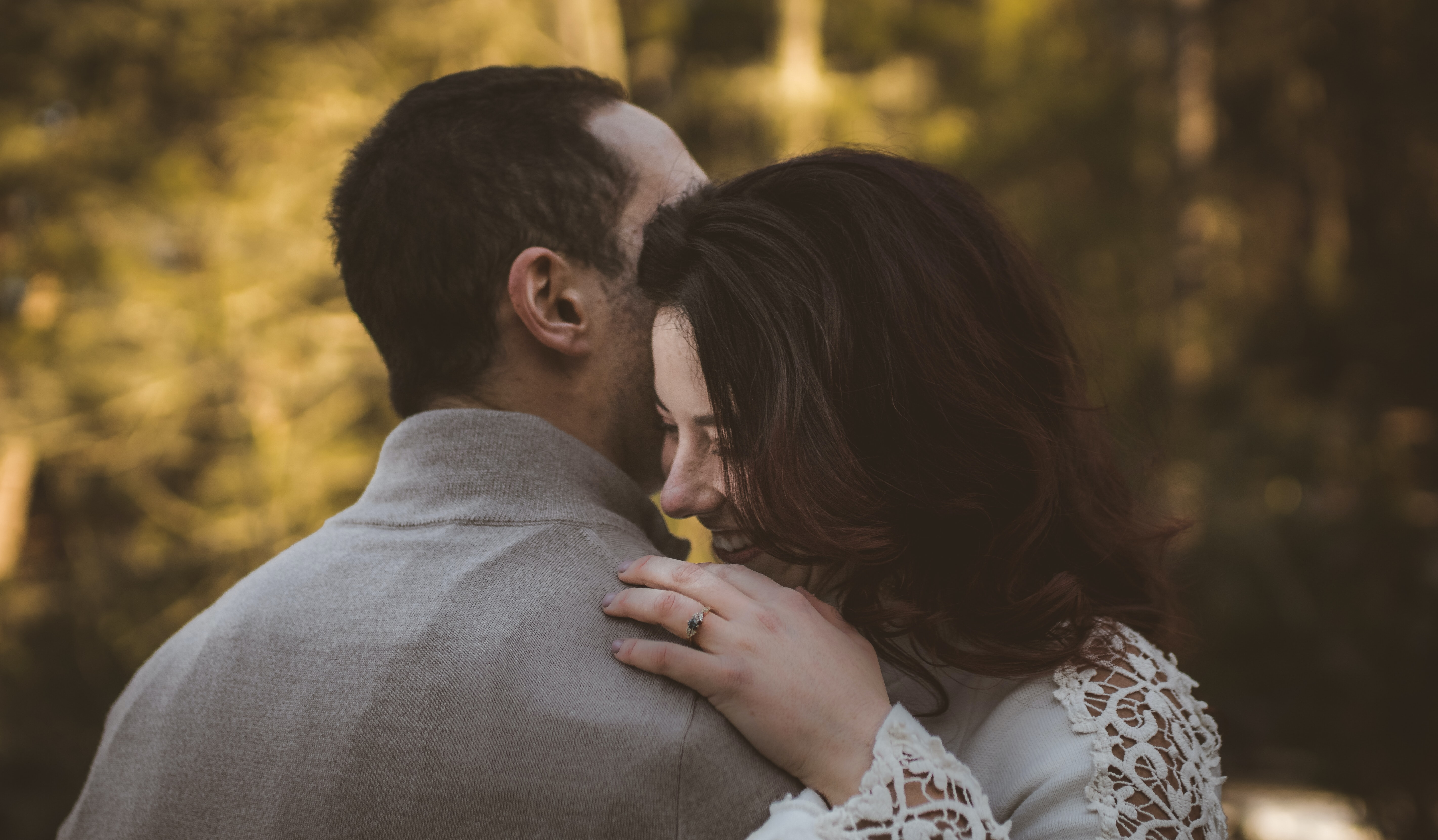 man and woman hugging each other during daytime