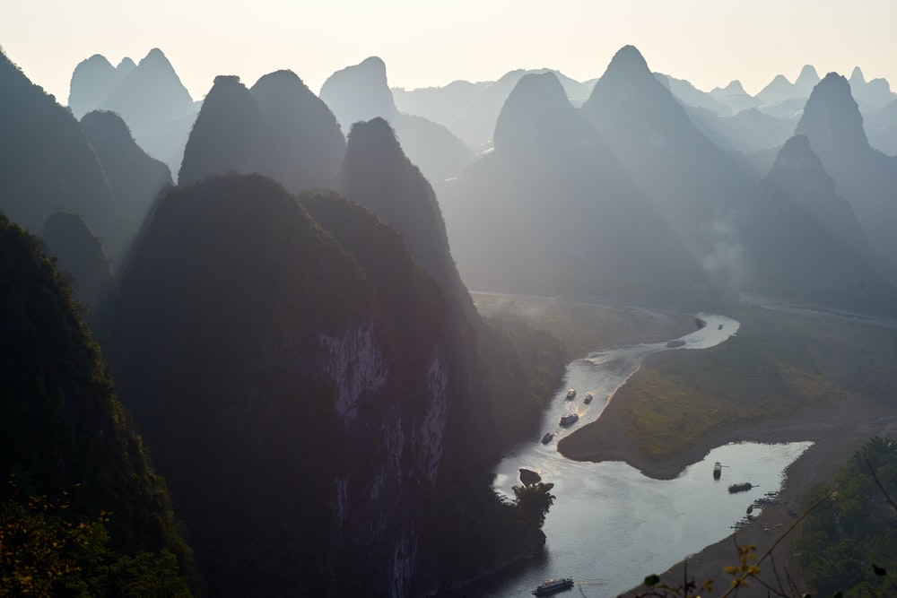 silhouette of rock formation and river during daytime