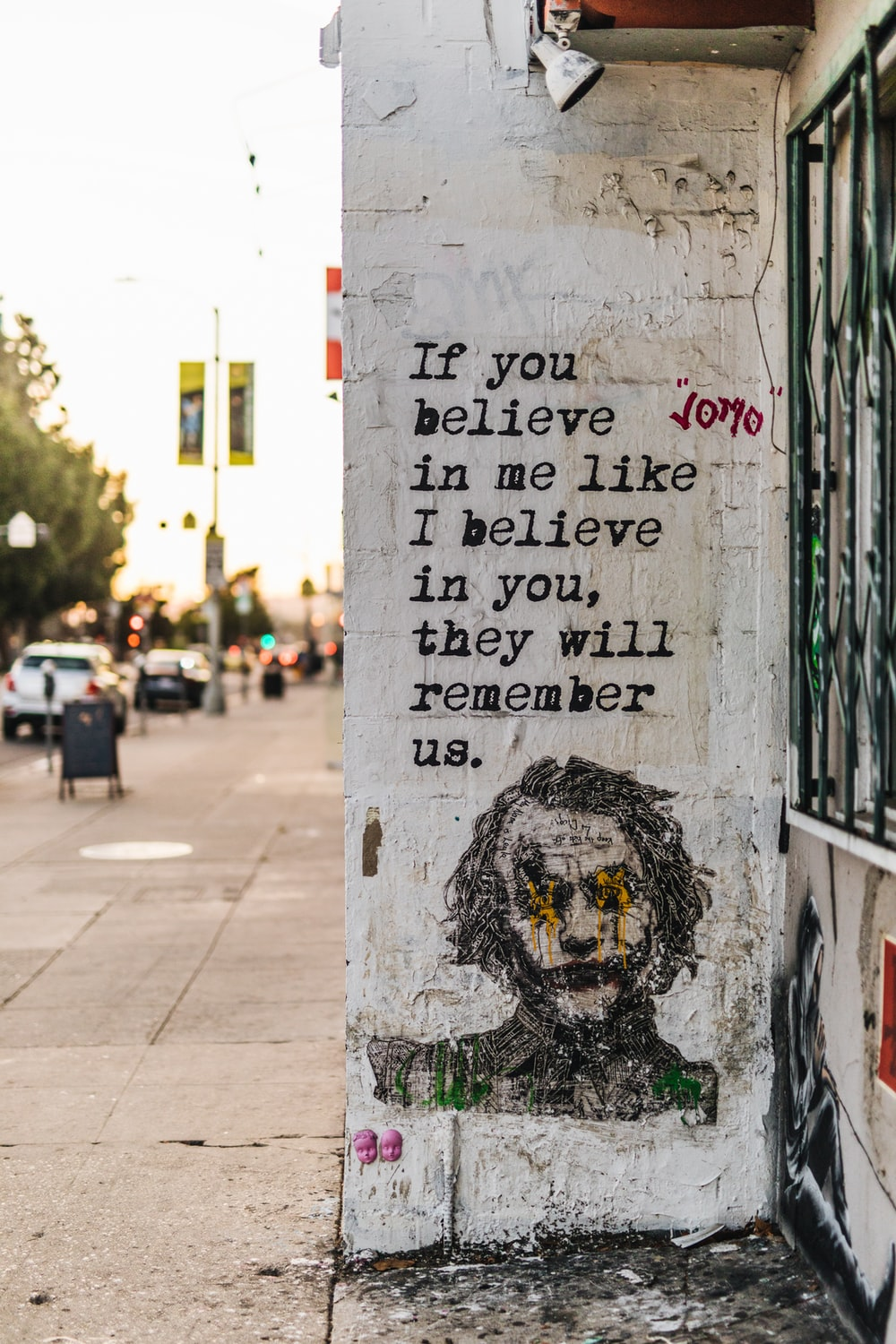 the joker quote painted on wall