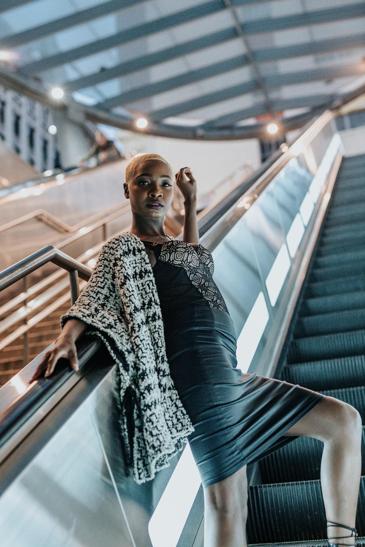 low-angle photography of woman on escalator