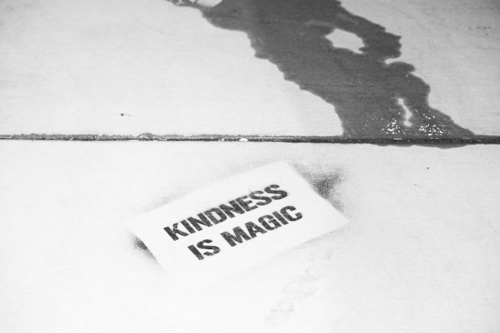 white and black Kindness is Magic text