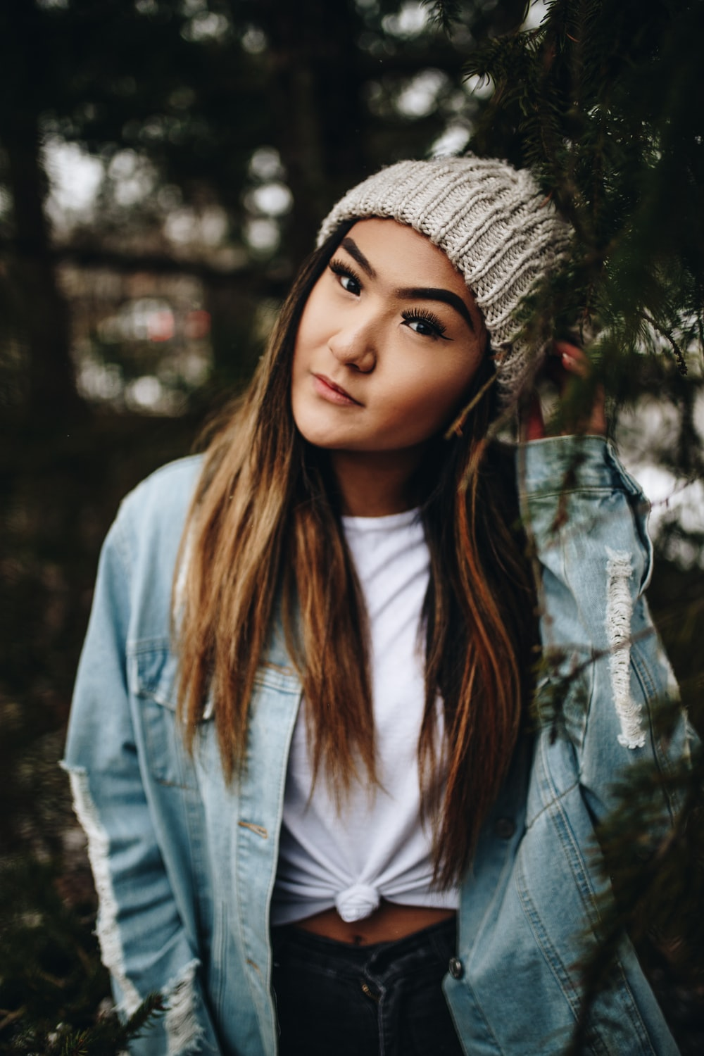 selective focus photography of woman wearing beanie and blue denim jacket