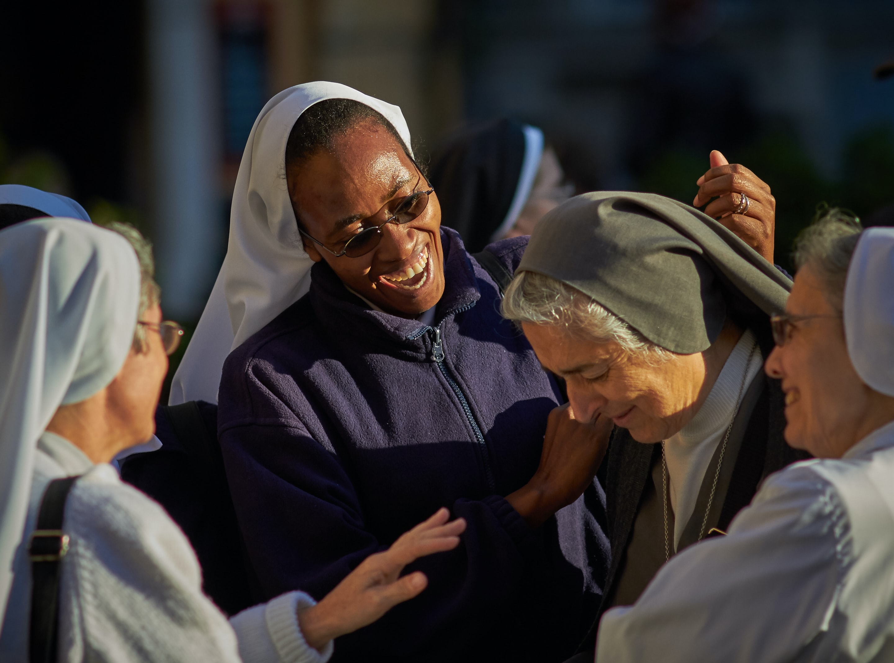 selective focus photo of group of nuns