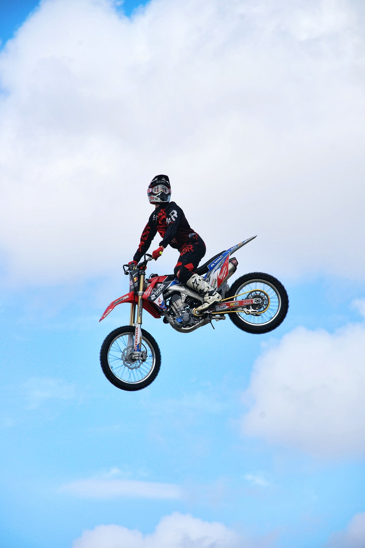 man riding dirt bike on air