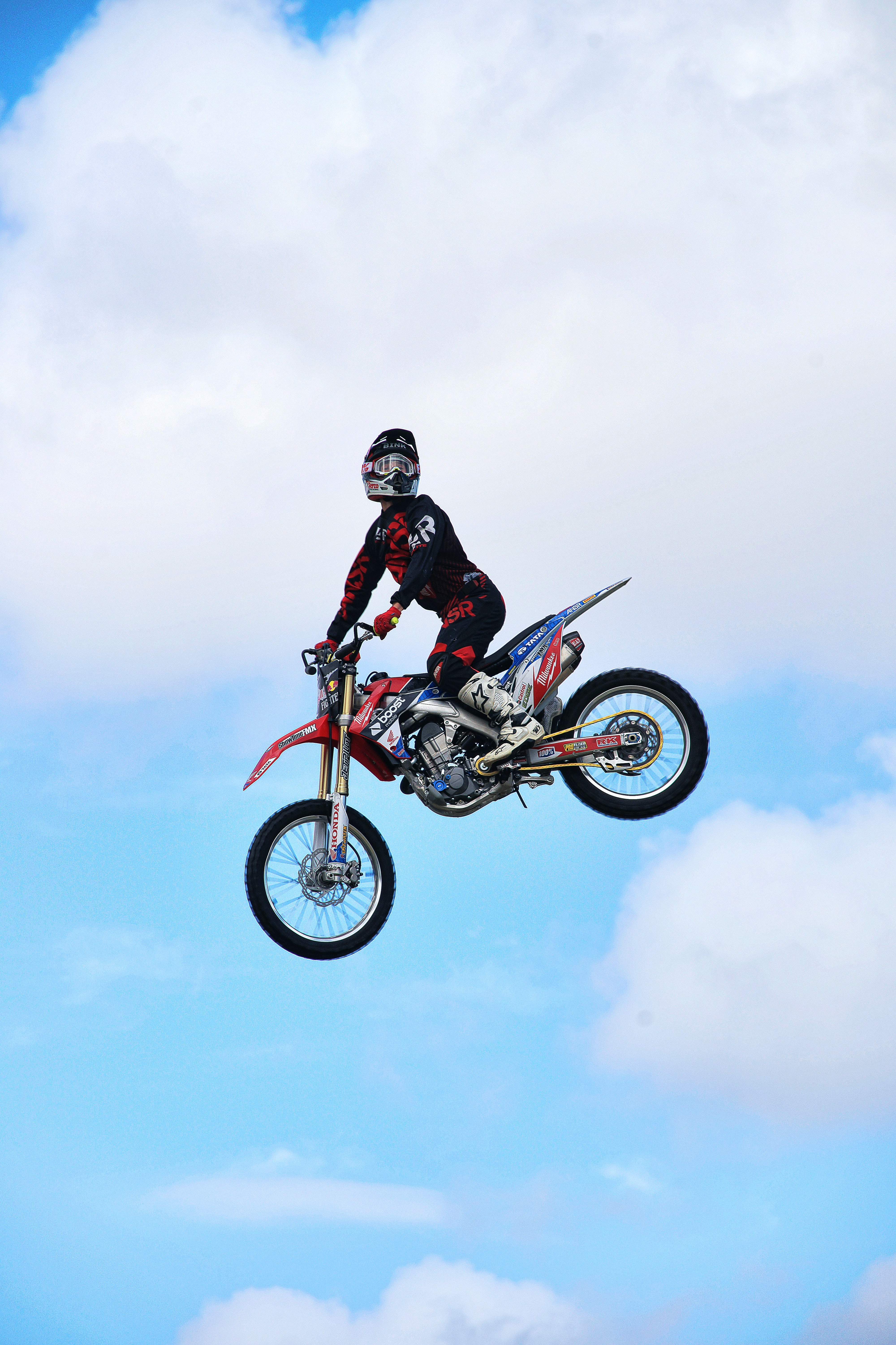 man riding dirt bike on air