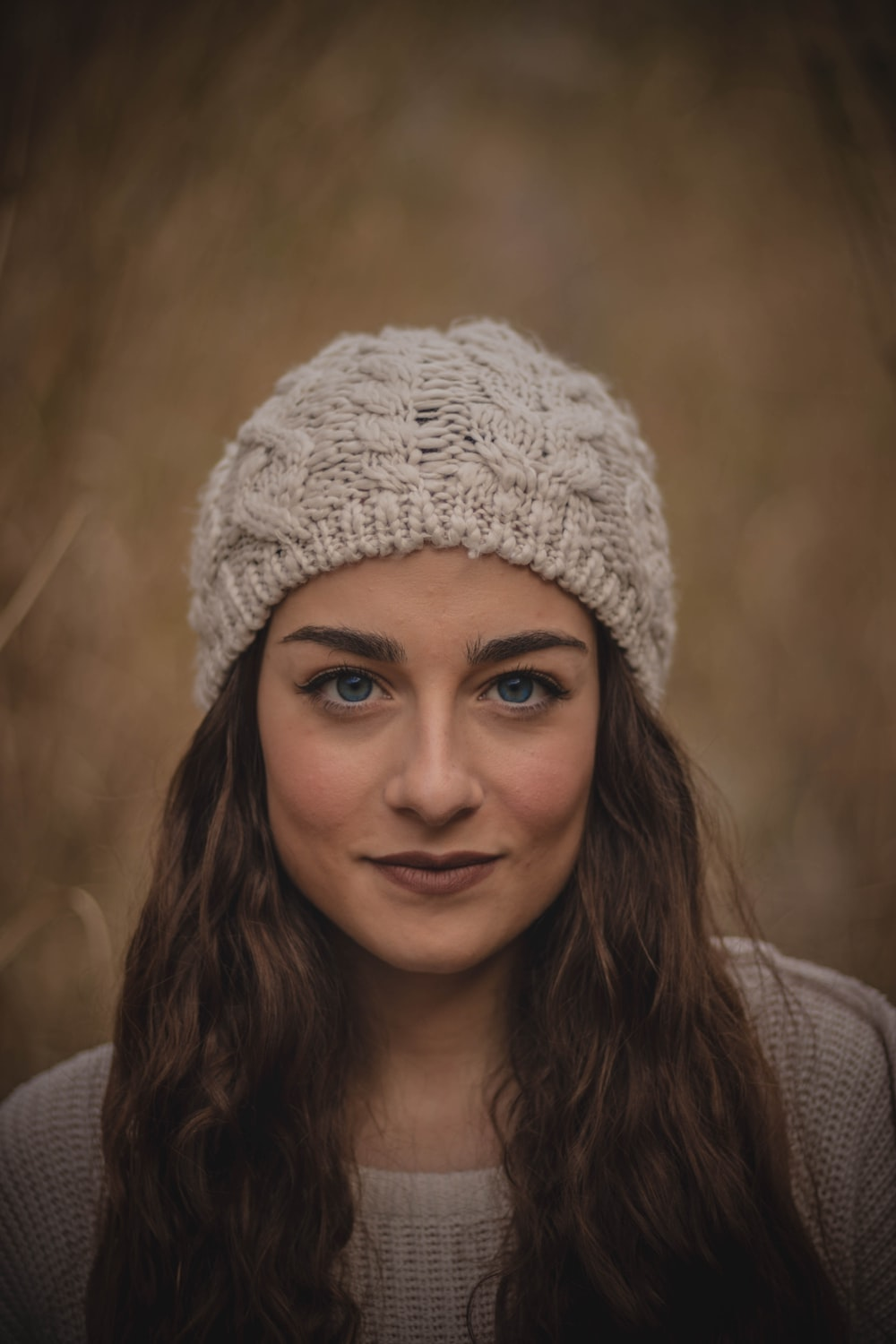 woman wearing a white beanie