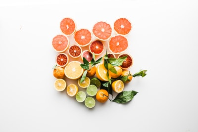 sliced fruit on white surface healthy teams background