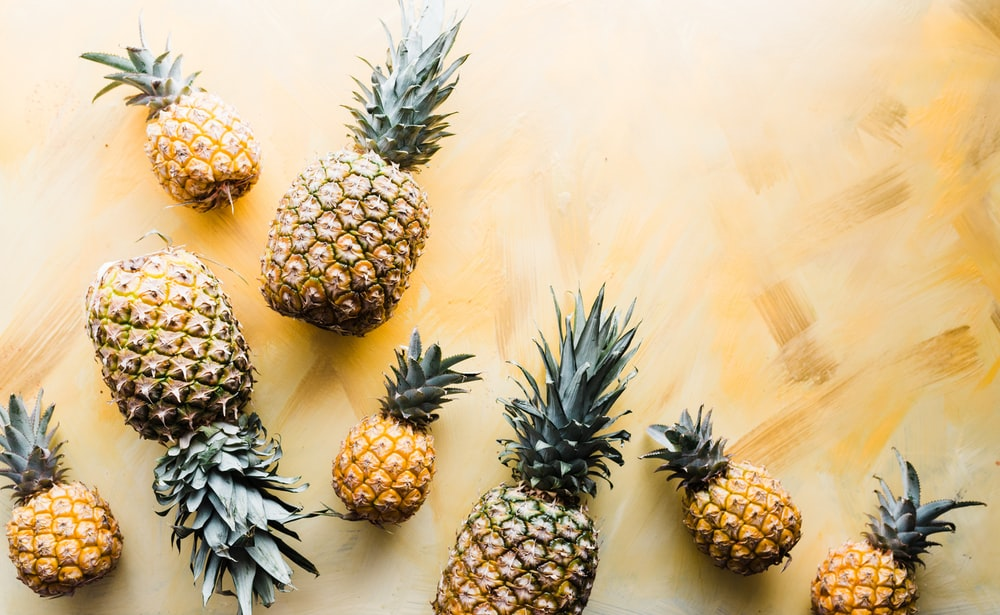 pineapples on brown surface