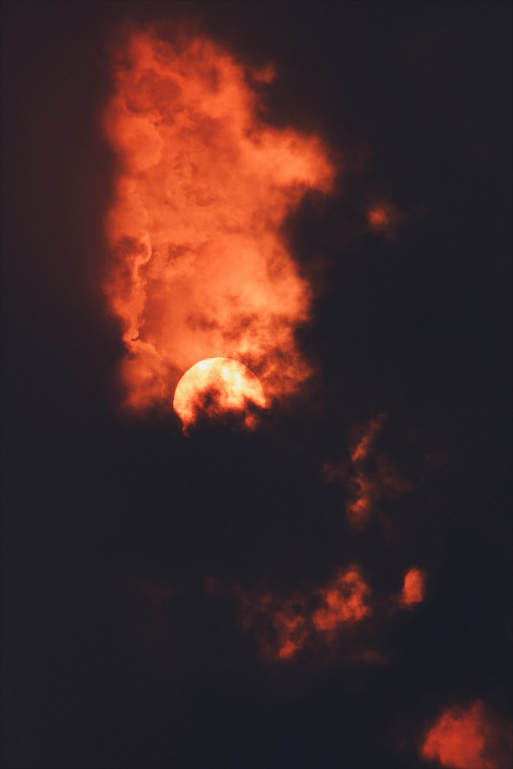 red full moon covered by clouds