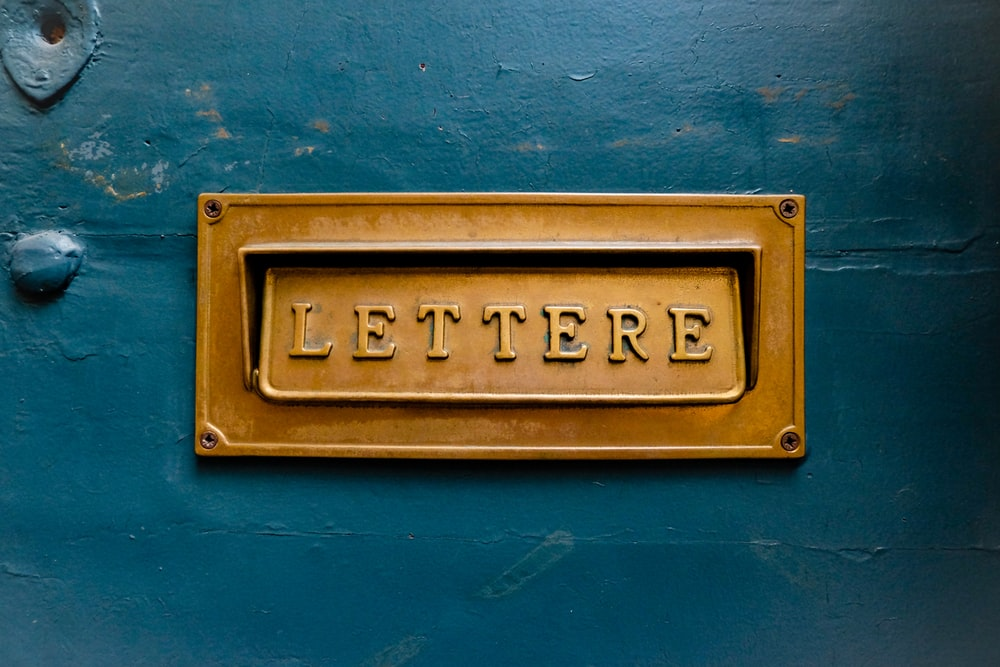 brown Lettere signage on teal trwall