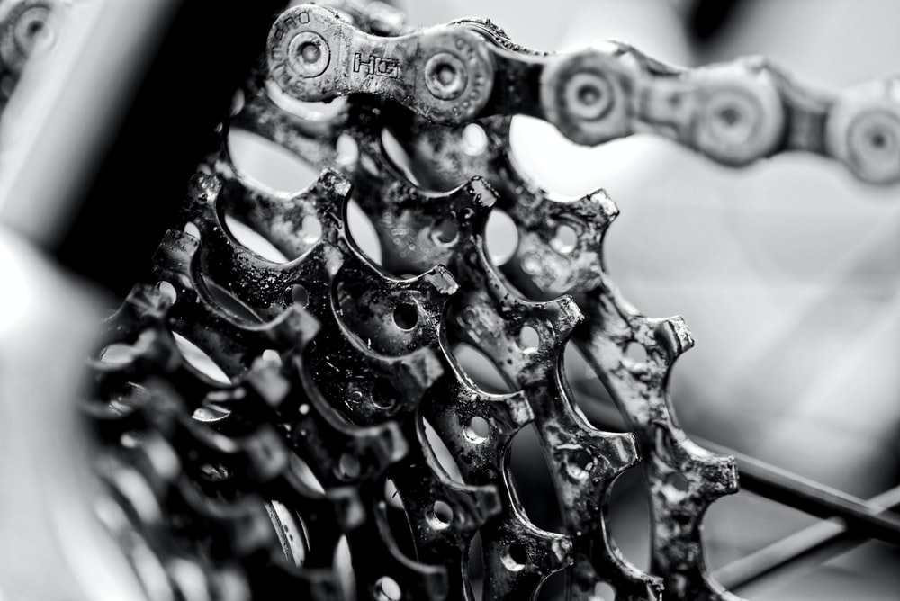 grayscale photo of bicycle derailleur