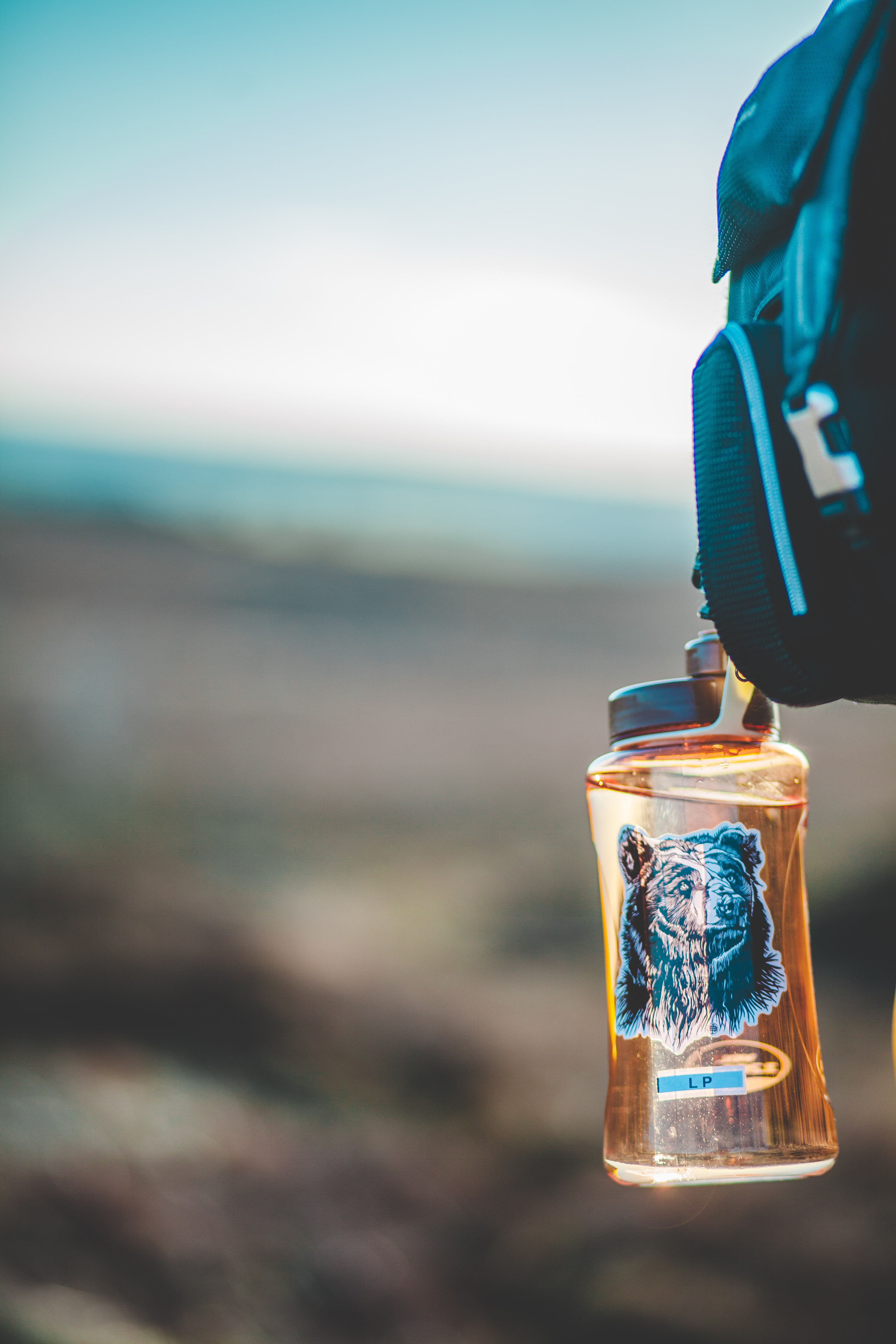 selective focus photo of brown plastic bottle