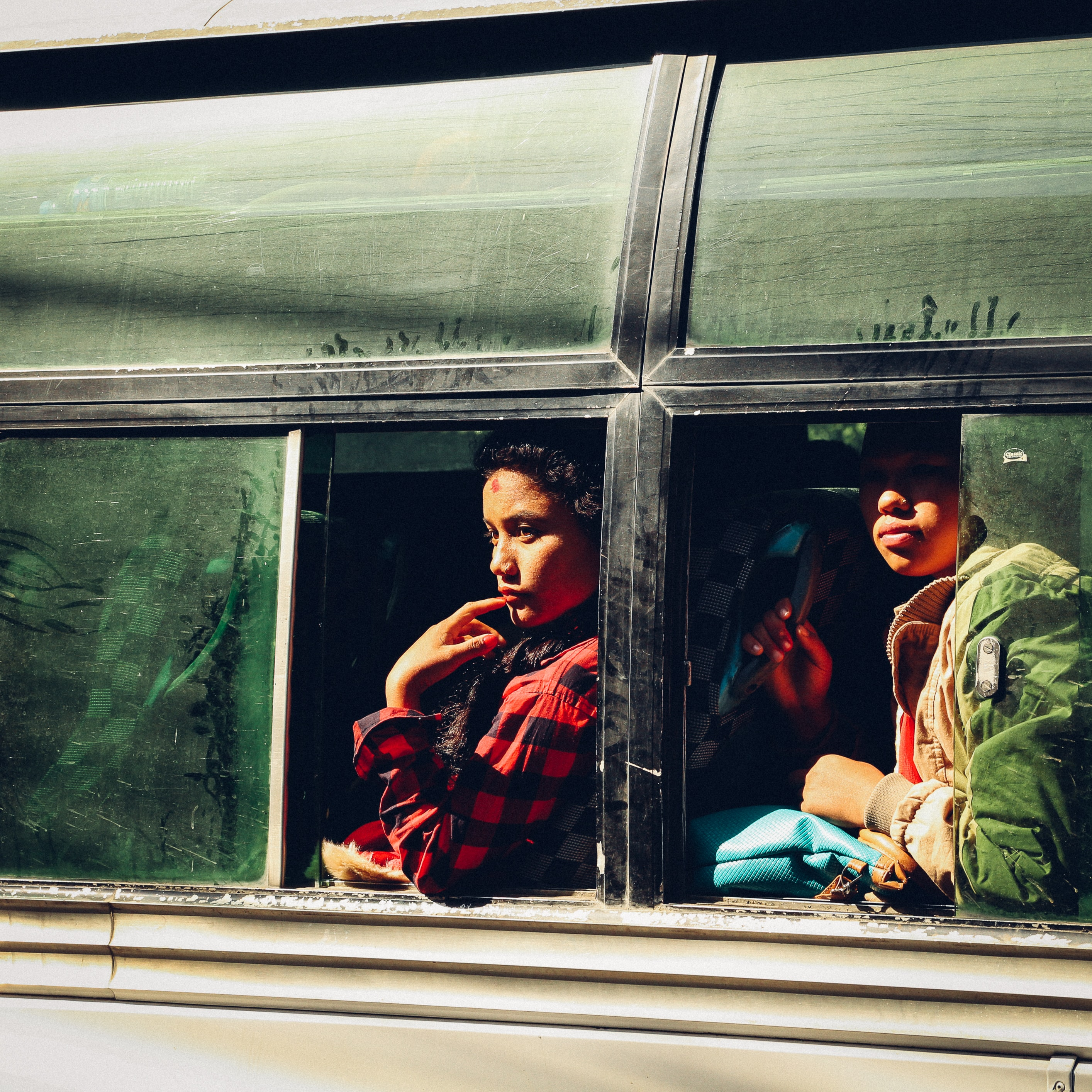 two people sitting on bus