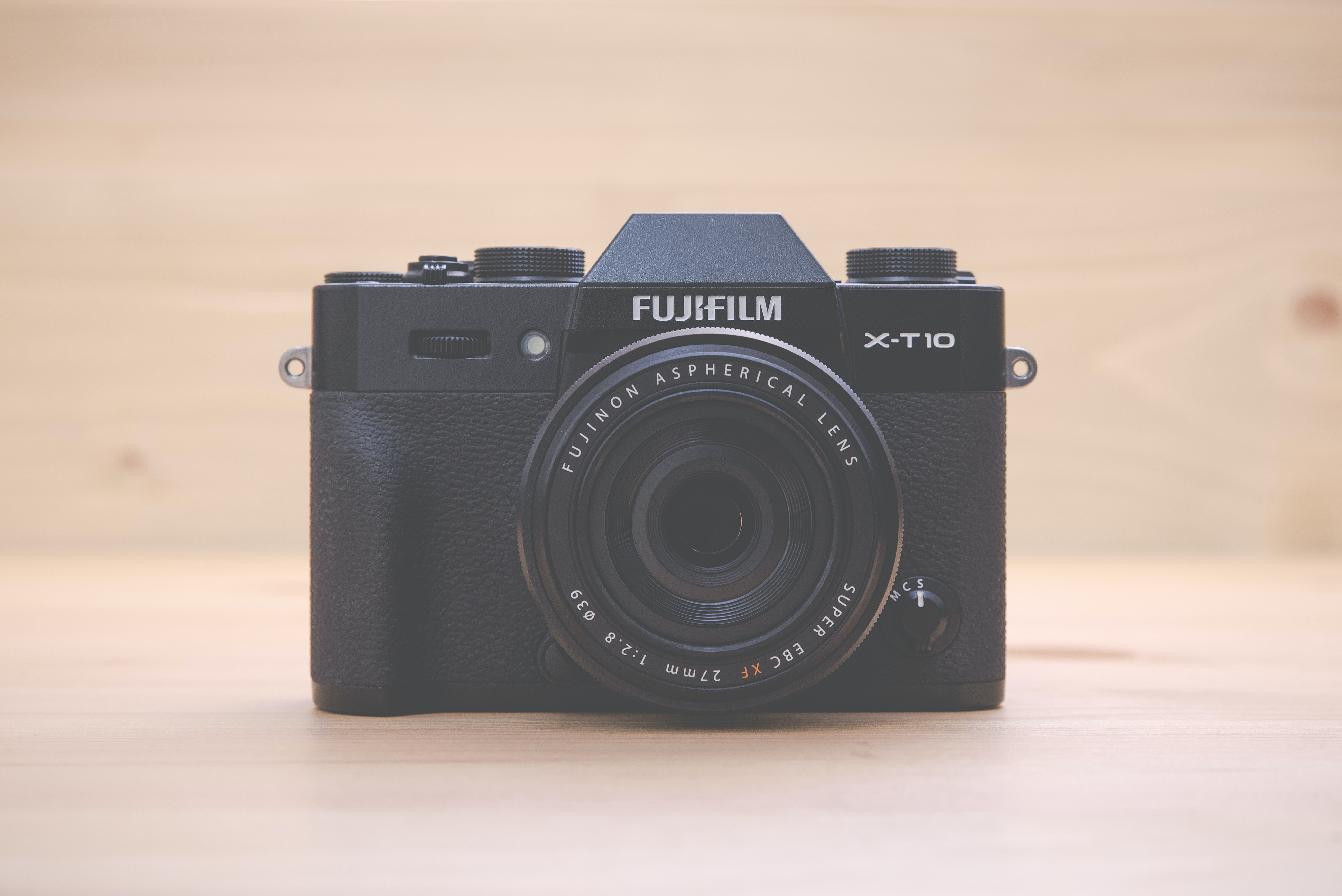 black Fujifilm X-T-HD point-and-shoot camera on brown surface