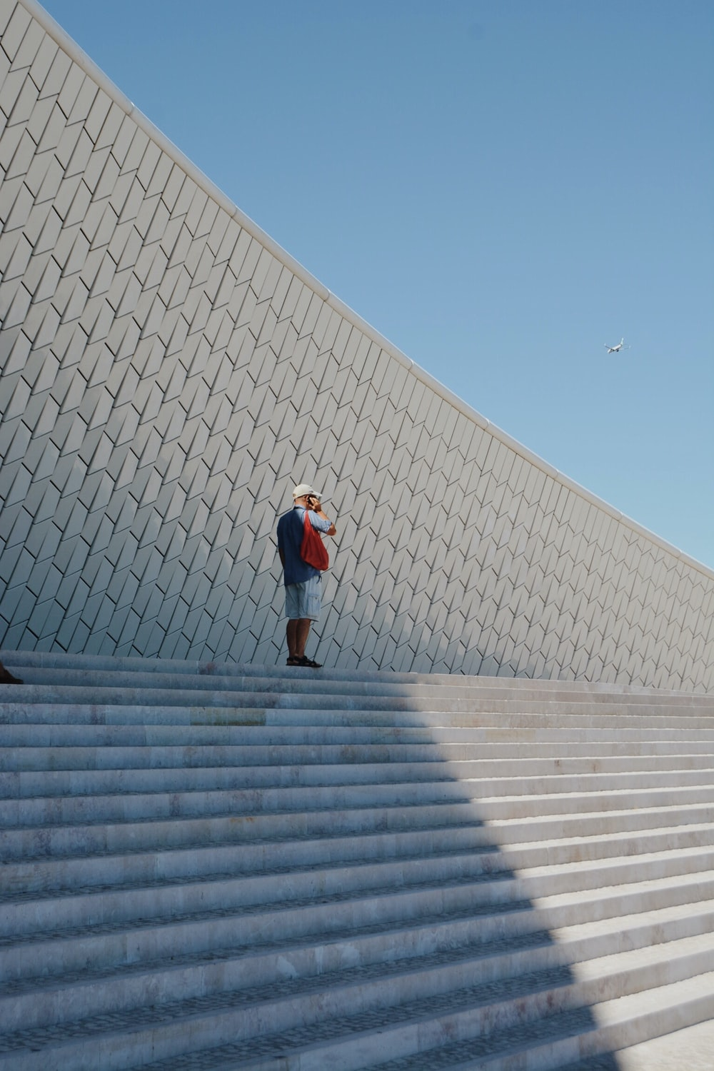 man standing near the stairs