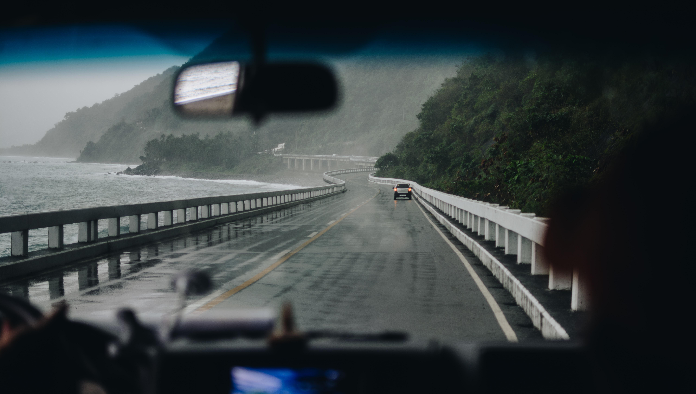 car on black and white concrete bridge