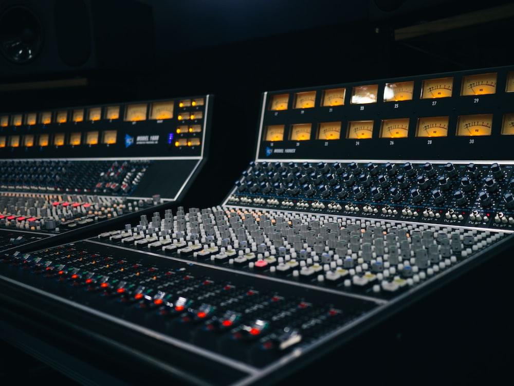 two black audio mixers