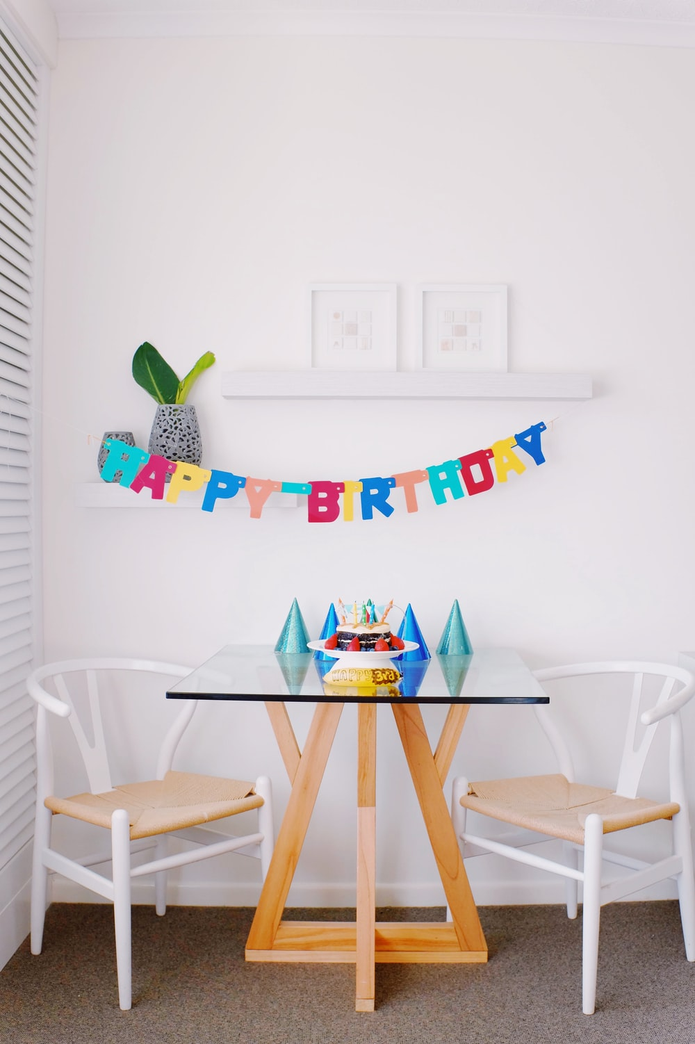 brown and white pub set and happy birthday hanging decor inside room