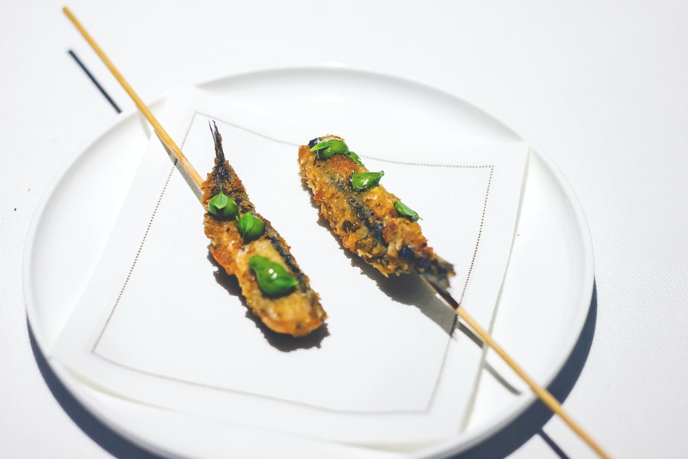 fried food with matcha toppings on plate