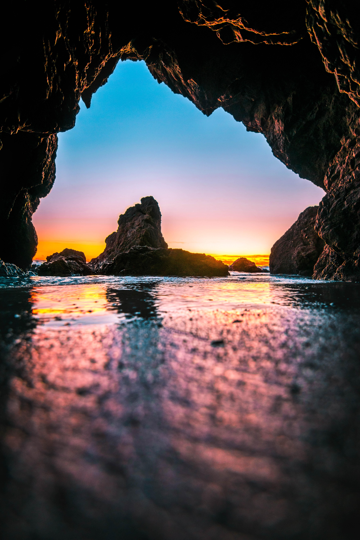 body of water under rock