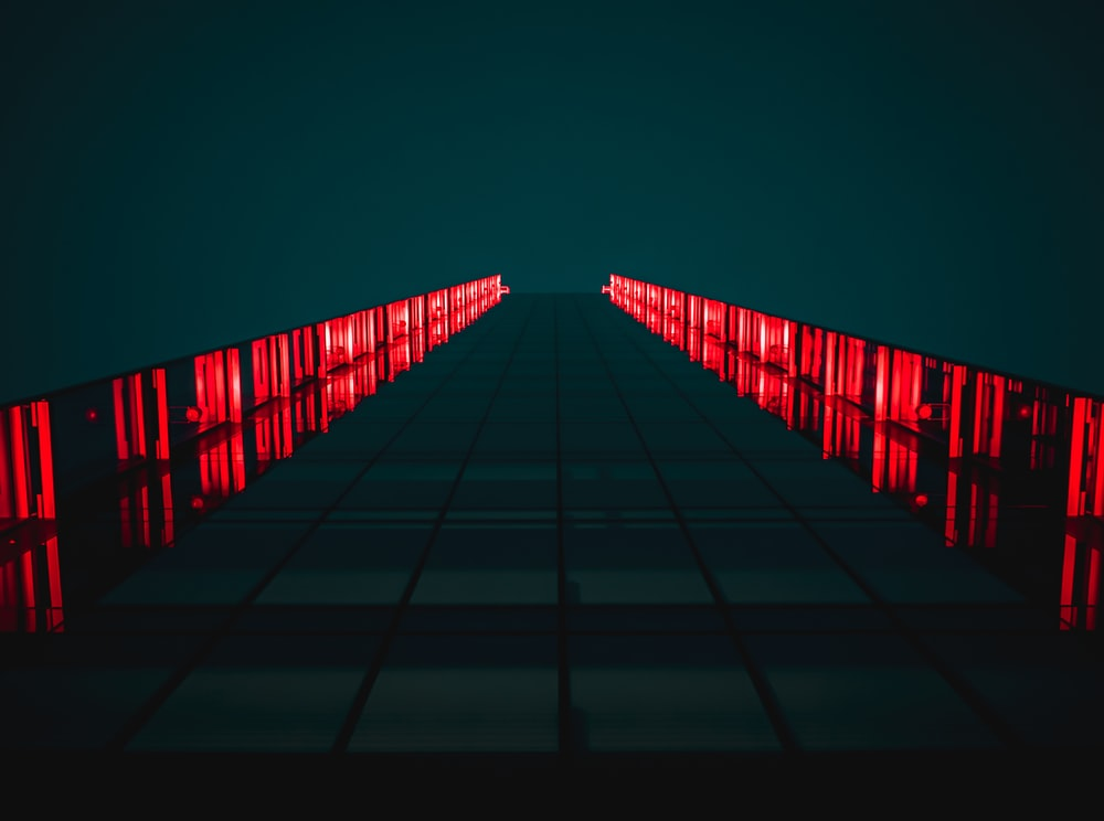 black pathway between red LED light rails