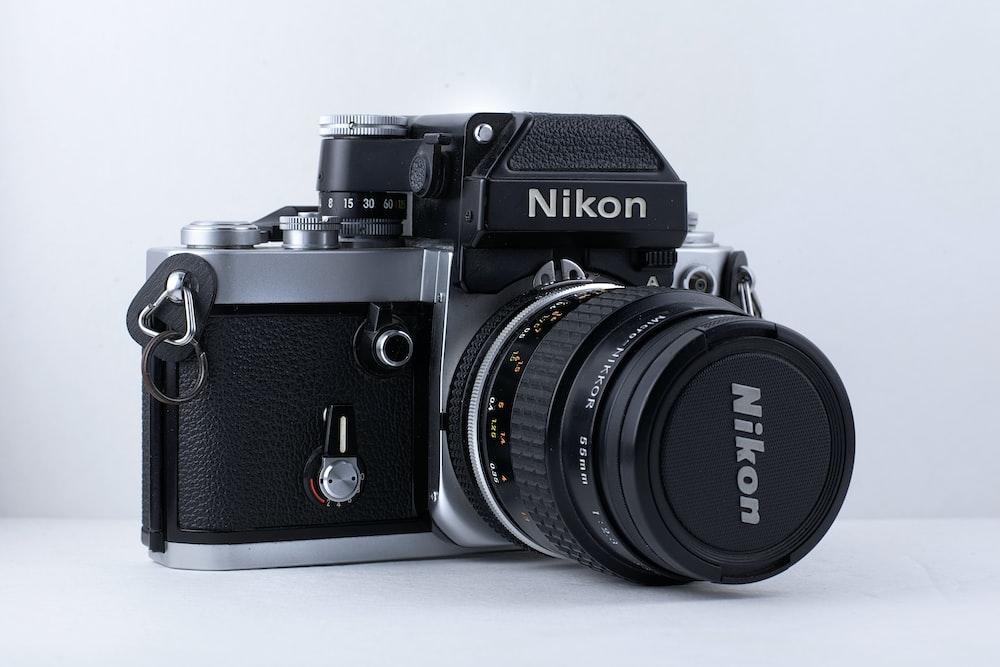 black and gray Nikon DSLR camera