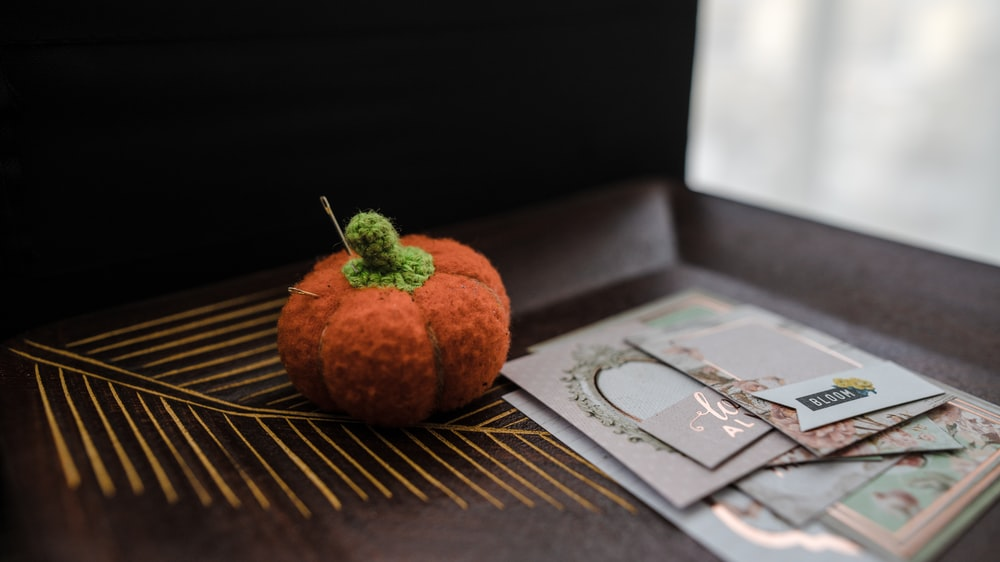 orange pumpkin pin cushion