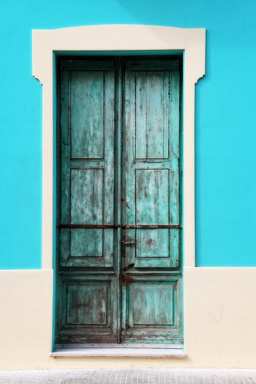 teal wooden door closed