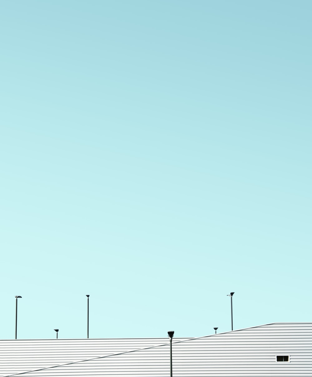 white roofs and teal sky