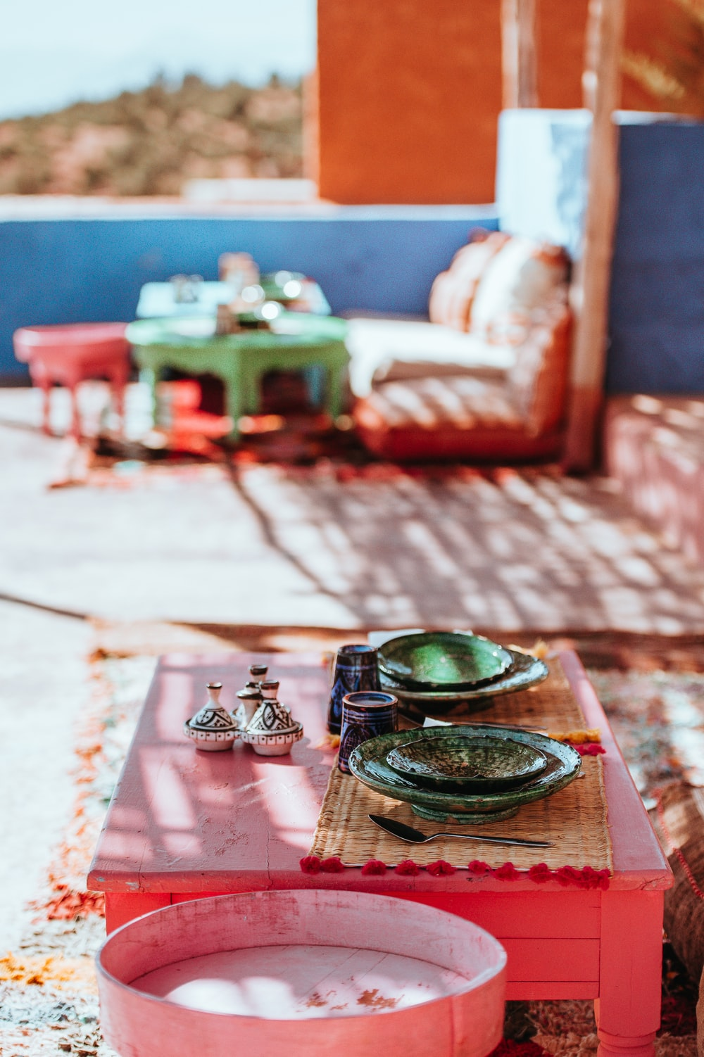 selective focus photography of traditional cups on coffee table
