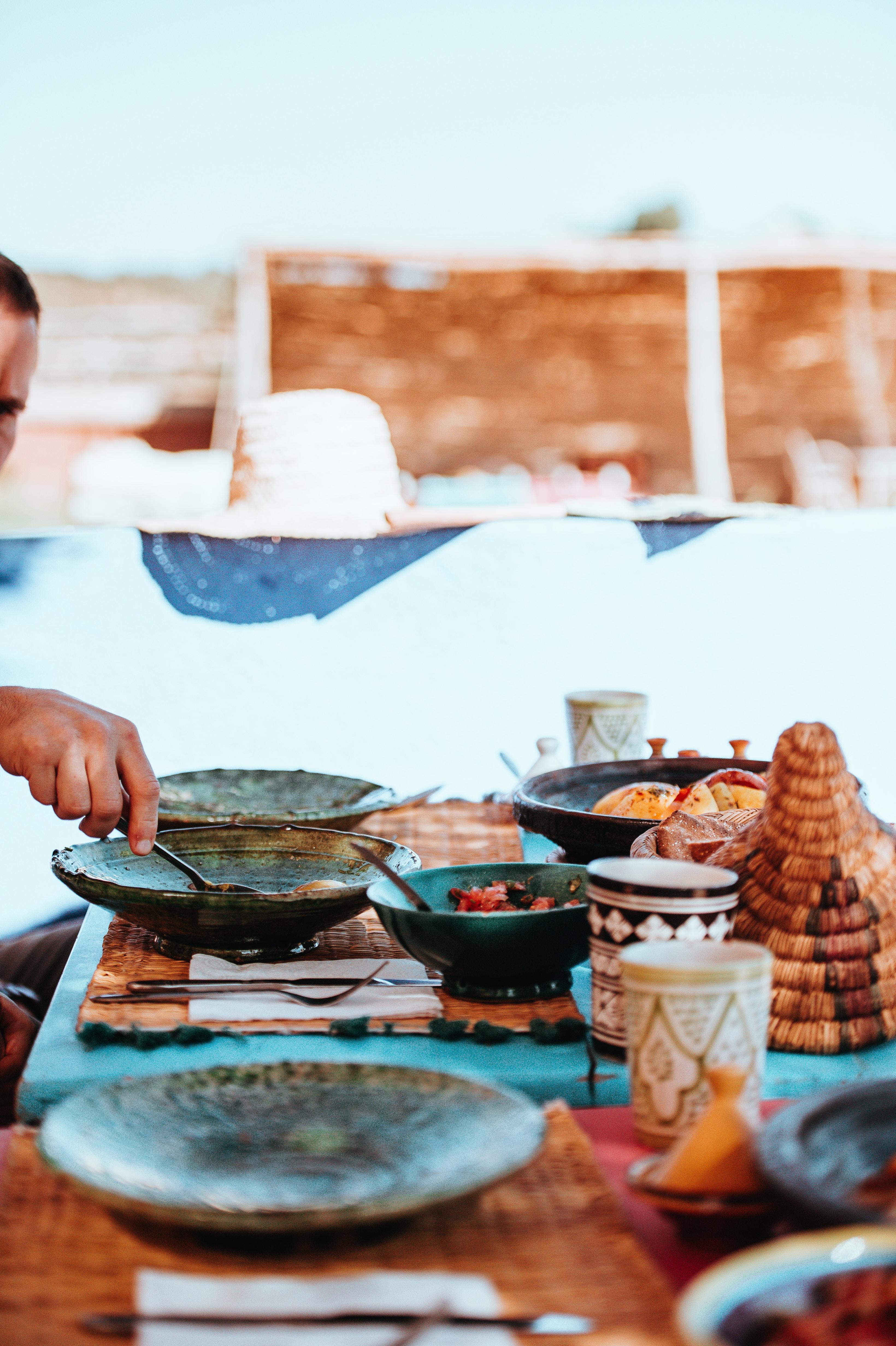 man cooking on gray wok during daytime